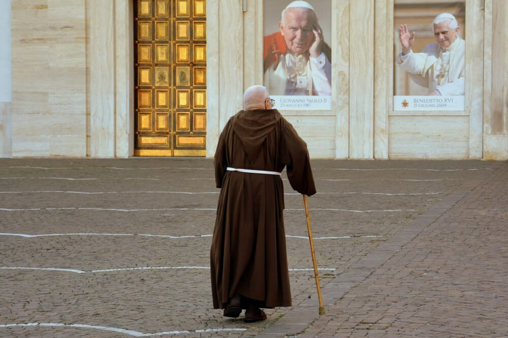 a friar looking at images of popes