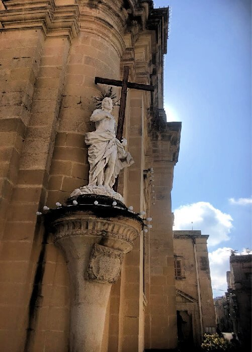A statue of Christ holding His cross in Rabat, Malta.