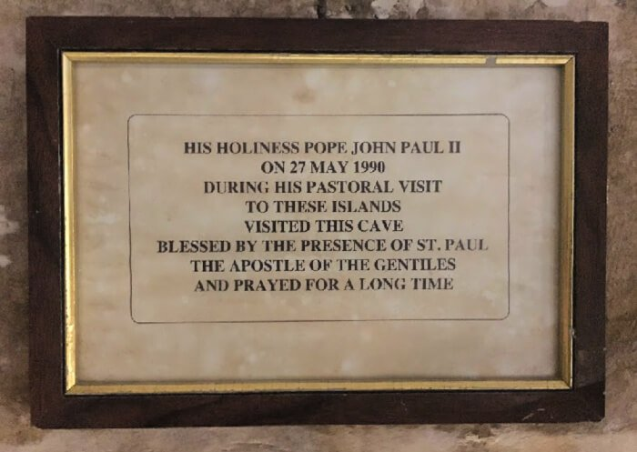 Pope St. John Paul II praying in St. Paul's grotto.