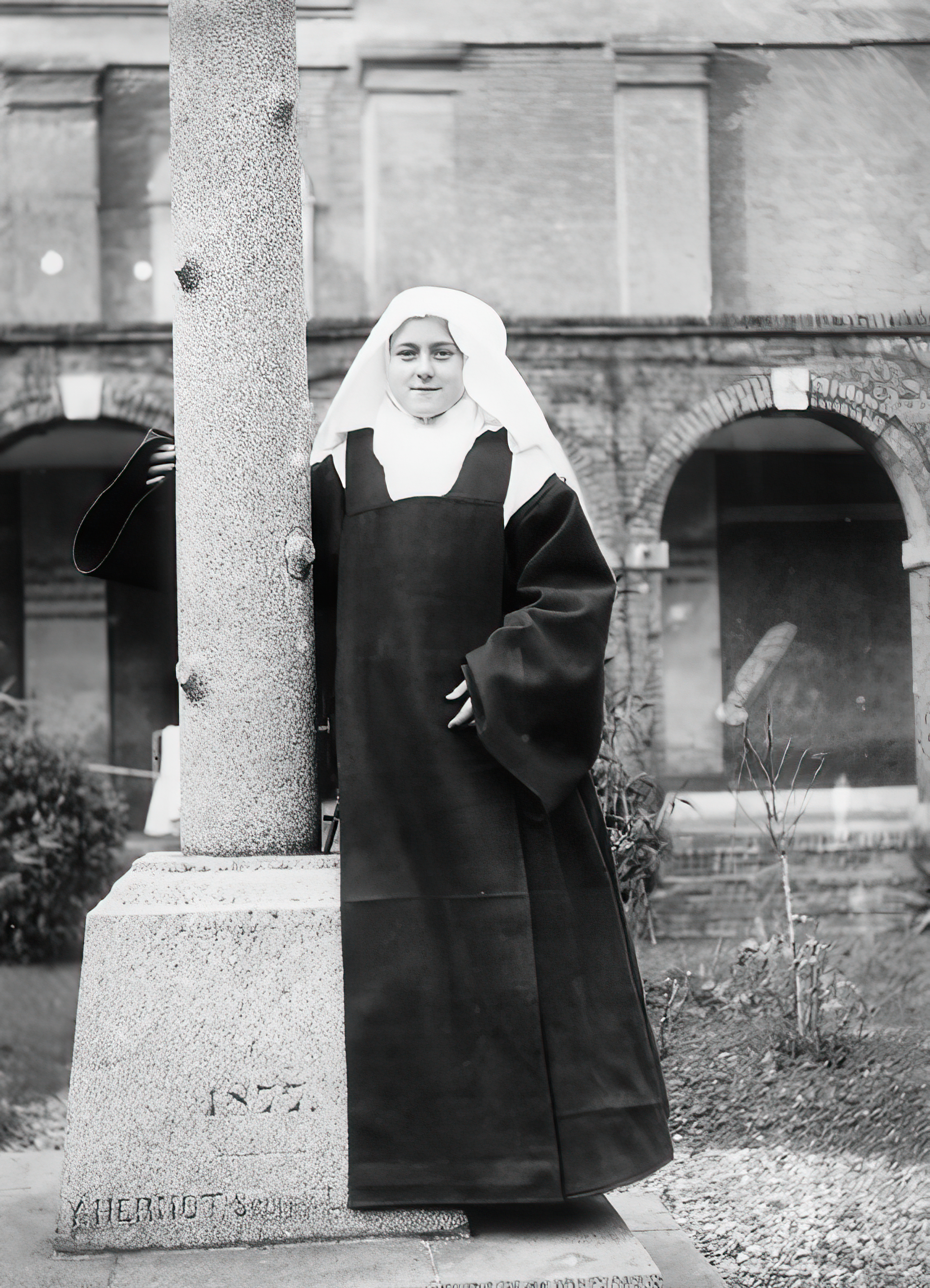 St Therese the Little Flower next to a pillar